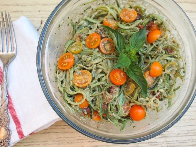raw zucchini pasta with pesto and sun dried tomatoes | bloom & nourish
