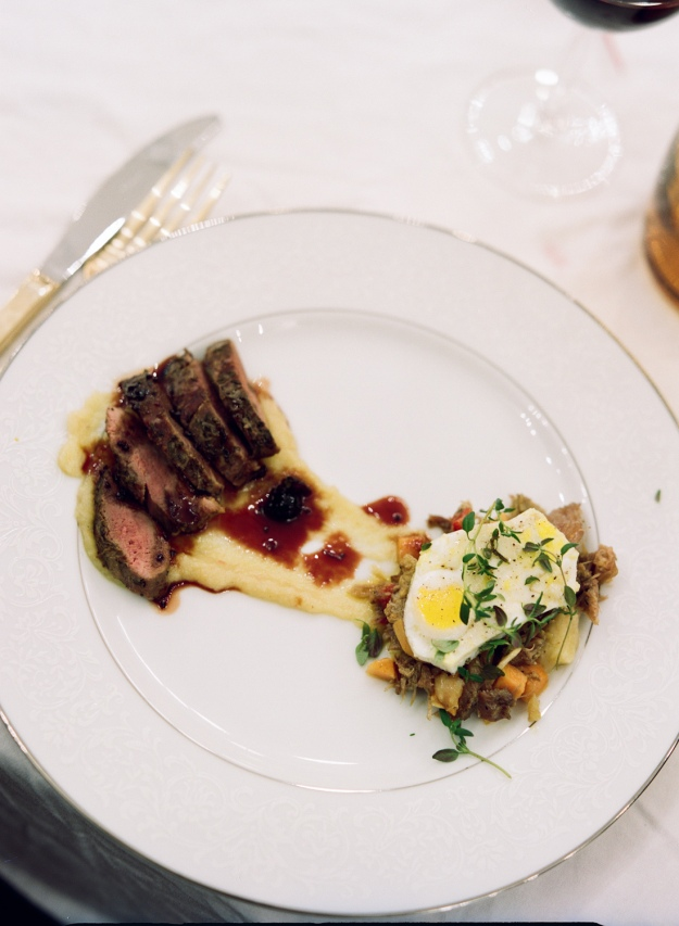 sous vide with a black currant gastrique and duck confit hash | bloom & nourish